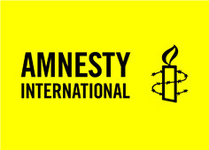 Amnestyy International Logo - Yellow background, with Amnesty International in black text, and an icon of a candle wrapped in barbed wire